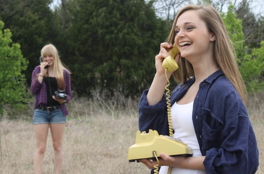Hosted Phone Systems Make Communication Easy - Image of two women talking on phones